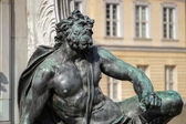 One of the four chained warriors at the base of King Frederic th — Stock Photo