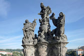 Statue of Saints Dominic and Thomas on Charles Bridge in Prague — Stock Photo