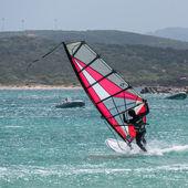 Man windsurfing at Porto Pollo in Sardinia on May 21, 2015. Unid — Stock Photo