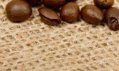Coffee beans on sack — Stock Photo