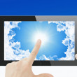 Tablet pc with sky background — Stock Photo #55438565