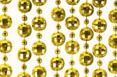 Brilliant celebratory beads of golden color — Stock Photo