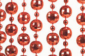 Brilliant celebratory beads of red color — Stock Photo