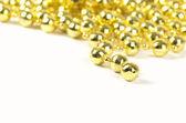 Brilliant celebratory beads of golden color — Stock Photo