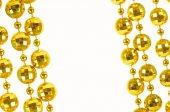 Golden celebratory beads — Stock Photo
