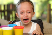 Boy crying in a summer school — Stock Photo