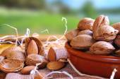 Group of almonds on a table in the field front view — Stock Photo