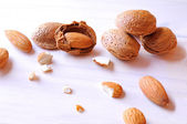 Group fo almonds on a white table top view — Stock Photo