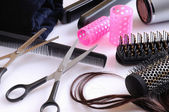 Set hairdressing articles exposed on a white table — Stock Photo