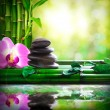 Stacked stones on bamboo reflected in water massage and relax — Stock Photo #78805798