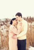 Sensual couple in winter field — Stock Photo