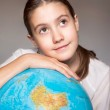 Back to school. Dreaming smiling girl with blue globe. Childhood — Stock Photo #55365803
