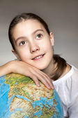 Back to school. Dreaming thoughtful girl with blue round globe.  — Stock Photo