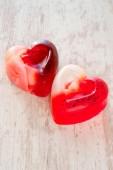 Two homemade heart shaped translucent soap. Closeup. — Stock Photo