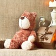Romantic present. Teddy bear toy with gift box and candles. — Stock Photo #64501443