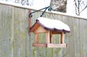 Hanging bird feeder covered by snow in winter. — Stock Photo