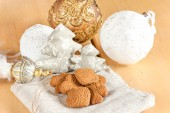 Preparing to christmas. Glass toys and ginger brown cookies. — Stock Photo