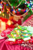 Homemade christmas tree shape gingerbread cookies on illuminated — Stock Photo