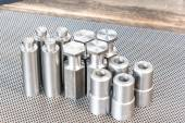 Iron details - shafts bolts nuts and cylinders. Metal engineerin — Stock Photo
