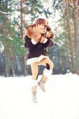 Winter enjoyment.Cheerful girl having fun in forest. — Stock Photo