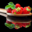 Strawberries fruit in big wood spoon with reflection — Stock Photo #67262351