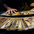 Man hand playing tarrot cards with slow speed — Stock Photo #71968881