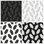 Vector set of black and white seamless patterns with falling oak leaves. Eps 10. — Stock Vector