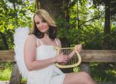 Angel woman with harp — Stock Photo