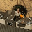 Man and woman sitting in old camera — Stock Photo #78657684
