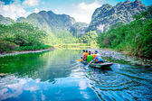 TRANGAN ECO-TOURIST COMPLEX, VIETNAM - NOVEMBER 27, 2014 - Tourists travelling by boat on the stream of the Complex. — Stock Photo