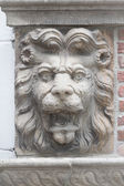 Lion sculpture on a wall — Stock Photo