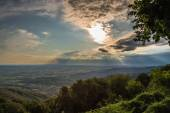 Sunset between clouds on italian countryside — Stock Photo