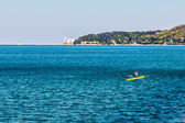 Canoeing in the evening in bay of Trieste — Stock Photo