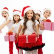 Group of happy kids in Christmas hat with presents — Stock Photo #57968805