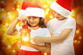 Happy kids in Santa hat  look at red Christmas lantern — Stock Photo