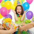 Joyful little kid girl receiving gifts at birthday party — Stock Photo #58450025
