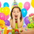 Joyful little kid girl receiving gifts at birthday party — Stock Photo #65238919