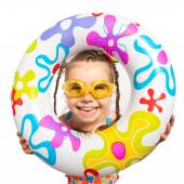 Happy kids look out of inflatable ring — Stock Photo