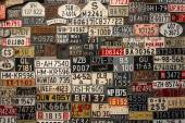License Plates on the wall — Stock Photo