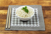 Plate of rice served on wooden table — Stock Photo