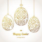 Golden ornamental eggs for your Easter design. — Stock vektor