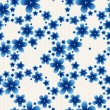 Blue floral seamless pattern on light background. — Stock Vector #73585833