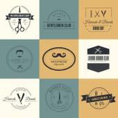 Set of barber and haircut logos — Stock Vector