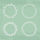 Round handdrawn wreaths — Stock Vector