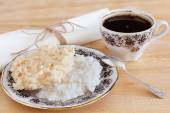 Brazilian dessert Coconut candy cocada on plate with cup of coff — Stock Photo