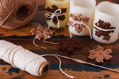 Christmas decoration of candle with handmade brown crochet snowf — Stock Photo