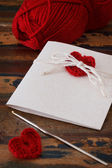 Handmade greetings card with red crochet heart for Saint Valenti — Stock Photo