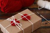 Saint Valentine decoration: handmade crochet red heart on gift p — Stock Photo