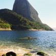 Mountain Sugarloaf Red beach sea sand man surfing canoe, Rio de — Stock Photo #67358315