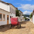 Coach on street, old colonial houses in Paraty, Brazil — Stock Photo #71464371